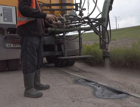 Город Каменское проводит ремонт дороги к дачным участкам Днепродзержинск