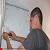 Сотрудники «УКОЖФ» г. Каменское помогают участнику АТО с ремонтом жилой комнаты